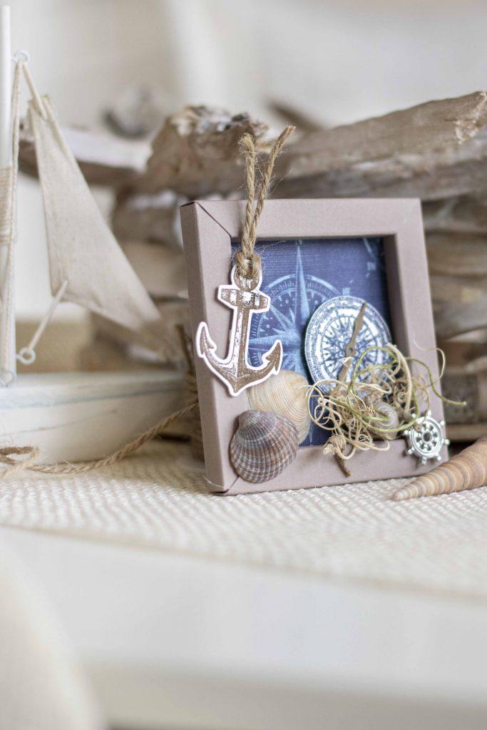 Origamirahmen maritimes Bild Leuchtturm Muscheln Materialbild